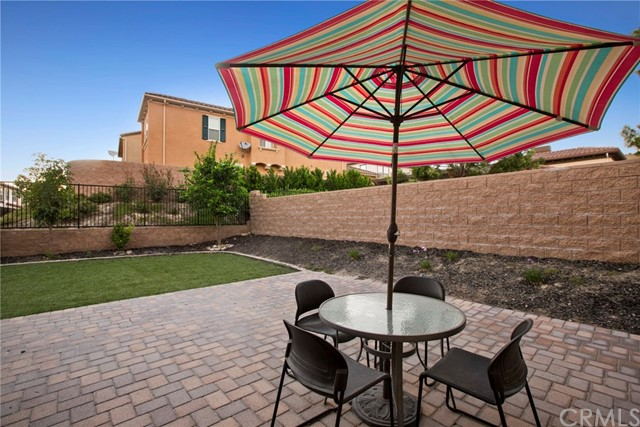 Model perfect Villagio DETACHED home with LARGE backyard with spacious patio, side yard and grass area * Seller entertaining offers from $748,888 to $798,888 * Located steps from beautiful Villagio comm pool area * This home is located approx .25 mile from Yorba Linda High and close to major shopping area * Beautiful floorplan with kitchen open to dining area and family room * Kitchen is airy and open, has great workspace, and has center island, breakfast bar, rich granite counter tops, beautiful cabinetry, sleek stainless steel appliances including double ovens, microwave, and a gas range * Family room is comfortable, has wood floors, French door leading to back yard * Entertaining is easy in dining area * Convenient main floor bedroom and full bath makes this a very popular floorplan * Spacious master suite with beautiful bath, walk in closet upstairs * Master bath has oval tub and separate shower and dual raised vanities, tile flooring, really nice * Two more secondary bedrooms upstairs plus hall bathroom with tub/shower combo * Upgraded flooring throughout, custom window coverings, fans, and more * Double car attached garage with direct access into home * And the back and side yards are GREAT with generously sized pavered patio area and side yard PLUS LOOK AT THE GRASS AREA - one of the LARGEST lots in the development * And right next door is the Villagio pool and spa area! This is a great opportunity to own this popular floorplan with a wonderful backyard!