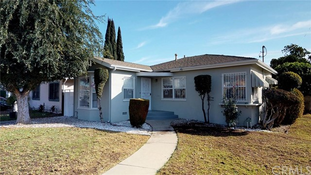 ***BEAUTIFULLY REMODELED SINGLE FAMILY HOME IN SOUTH EAST COMPTON***  This 3 bedroom, 2 bathroom home (tax records show as 4 bed/2 bath) features include:  living room entry with new flooring, paint, new light/fan fixture, faux fireplace, new paint, new window treatments.  Formal dining room with new flooring, new light/fan fixture, new paint, new window treatments.  Off of the dining room is a breakfast nook with new flooring, new light fixture, new custom built-ins, new window treatments and opens to the bright and airy kitchen with new cabinets, new counter tops, new double stainless steel sink, new stainless steel appliances and new backsplash with access to laundry/utility room with rear door that opens out to covered patio, hardscaped backyard and 2 car detached garage.  The main hallway off of the dining room affords access to 3 bedrooms and 2 bathroom with separate bath tub/shower and 1 bathroom has a separate vanity area.  Plus there is an additional expansive master bedroom with fireplace, new flooring, new ceiling fan/light fixture, new paint and glass slider which leads out to covered patio and the hardscaped backyard.  DON'T MISS OUT ON THIS OPPORTUNITY TO OWN THIS BEAUTIFUL CORNER LOT HOME!