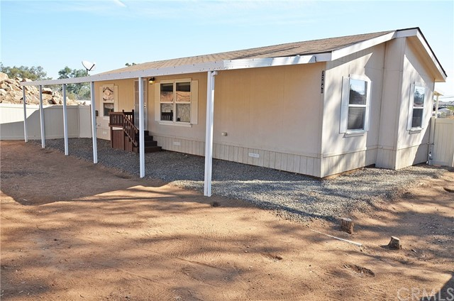 ****This Homeowner is Motivated Two Turnkey single story homes for sale on a 1.41 Acre lot****This property has it all a huge 1.41 Acre lot with lots of flat usable space and 2 manufactured homes on permanent foundations.  The first home was built in 2006 features 3 bedrooms and 2 bathrooms with open concept living. The home has lots of upgrades including Granite counter tops in the kitchen as well as both bathrooms, deep farmhouse sink in the kitchen and custom cabinets. The master bedroom has a walk-in closet as well as a large master bath. The second home was builtin 1979 and features 1 bedroom with a bonus room and 2 bathrooms. This home is getting new carpet on October 1st and has lots of upgrades including a new Kitchen. Both homes come with all the appliances you see including Refrigerators stackable washer/dryer and all flat screen TV's. Also included are 2 storage sheds and a barn to use as you see fit. This is a great home for anyone looking for outdoor space.