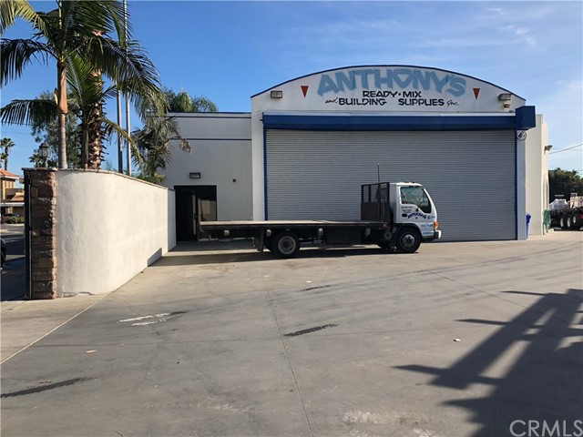 Approx 2000 sq ft of building plus a yard for lease. Could be a number of uses.  There is a lift inside the building plus office and 1/2 bath plus small storage area.  Electronic gate opens to Manhattan Beach Blvd. Just east of the 405 freeway. Office has a small A/C unit.