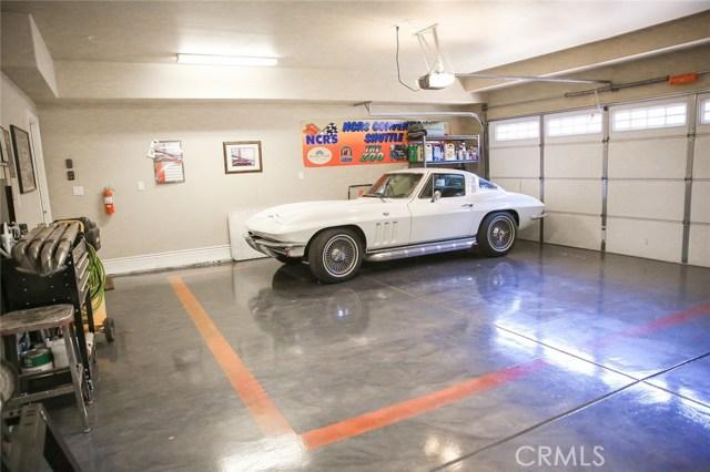 Three car garage has a side lift garage door opene