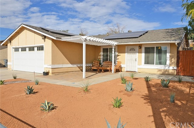 ***SOLAR IS PAID OFF*** This single story home is located next to shopping and within walking distance of San Jacinto High School. This home has it all 4 bedrooms and 2 bathrooms new paint as well as upgraded windows and 12 solar panels that wipe out your electric bill and are already paid off. The Front yard was newly landscaped with lovely water friendly desert scape and green plants as well as RV parking. The kitchen has lots of cabinet space and has access to the double doors that take you to the large backyard. All the bedrooms are large in size and the master room has built-ins as well as a great bathroom. The living room and dining room are open concept and the neighborhood is surrounded by the lovely San Jacinto Mountains.The roof is less than 3 years old and the solar panels are less than 2 years old with an extended warranty.  This home will not last, this is a must see.