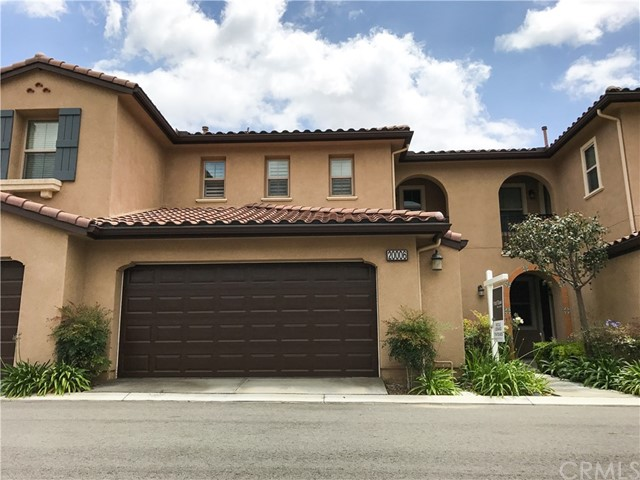Above Bastanchury Rd, minutes away from Yorba Linda High School, and close to everything Yorba Linda has to offer!  Built in 2010, this community is perfect for entertaining!  Walk into your new home and you'll notice the fresh paint, pristine flooring, granite counter tops, stainless steel appliances, and an open family room.  Walk upstairs to two bedrooms, each with their own bathroom, and a full laundry room.  The community pool and spa are available for a nice relaxing weekend and the playground is ready for the kids to enjoy.  This beautiful community is surrounded by million dollar homes, making it one of the best purchases in town.  Come take a look!