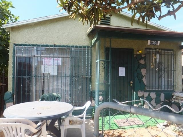 ***SINGLE FAMILY;Y HOME IN COMPTON*** This 2 bedroom, 1 bathroom home features a concrete walkway to a covered front porch to a living room entry with ceiling fan light. Left is a family room (originally a garage conversion?). The living room appears to have a gas line where the wall furnace originally existed; there is no heat source currently. The hallway includes a hall closet to a full bathroom (combination tub/shower)... and on to bedroom 1 on the left... hallway continues to bedroom 2 on the left and right to a space-saver kitchen with a double sink and adjacent breakfast area and inside laundry area. 1 step down to an enclosed patio and a storage shed in the wood and chain-link fenced backyard. ***HURRY - DON'T MISS THIS OPPORTUNITY!!!***