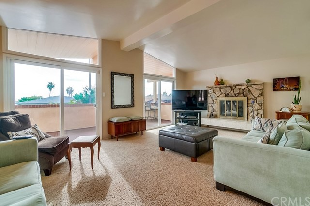 """Tastefully upgraded one-level home located near the end of a cul-de-sac in desirable upper South Shores location. Bright sunlit living room features a vaulted ceiling, fireplace and a wall of glass with sliders that open up to the large balcony that is the perfect spot to enjoy a morning cup of coffee while taking in the fresh ocean air and ocean/Catalina views. The gorgeous kitchen will please the fussiest gourmet & comes complete with custom wood cabinetry (including roll-out shelves), a 36"""" Wolf 6 burner range and hood, farmhouse sink, built-in Subzero refrigerator, granite counters and tile backsplash. The spacious dining area adjacent to the kitchen is large enough to accommodate a table that will seat the entire family for holiday gatherings. Tile floors set in a French pattern run through the entry, kitchen and dining area to create a very inviting space. Main hall leads you to the three secondary bedrooms and the remodeled hall bath that features a large walk-in shower and stone/granite finishes. At the end of the hall is the private master suite that features a lavishly upgraded bathroom that includes a custom vanity with unique sink, large spa tub, separate shower with frameless glass enclosure & high-quality fixtures. Rear yard features a large patio and gradually sloped grassy area that features some ocean/Catalina view from the top. There's a 2 car garage, large walk-in storage area under the house and additional driveway parking for extra cars and guests. HURRY!"""