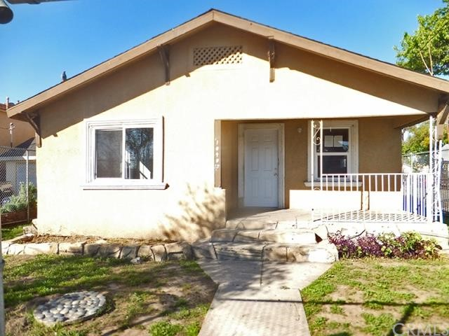 ***JUST LISTED HUD HOME IN WATTS NEIGHBORHOOD OF LOS ANGELES*** This 4 bedroom, 2 bathroom HUD Home features include: 3 steps up to a covered front porch opening to a tiled combination living room and kitchen with granite-like counter tops, double stainless steel sink with garbage disposal and vent hood.  The first hallway features inside laundry closet and the rear hallway affords access to the owner's suite with a private full bathroom.  The rear door opens to a large fenced yard with an open concrete patio and off street parking.  DON'T MISS OUT ON THIS OPPORTUNITY!!!