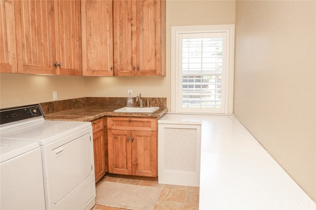 Laundry room has an extra deep sink with granite t