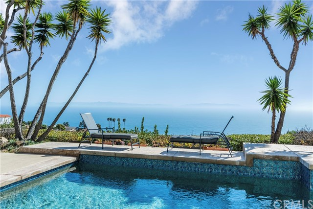 Enjoy panoramic ocean and Catalina views from most rooms in this light and bright home.  Located towards the end of a quiet cul-de-sac, this charming home has fresh paint, new carpeting and a sparkling pool overlooking the magnificent views!  The split level floor plan includes a spacious living room and formal dining room, a cozy kitchen with adjacent eating area, and a large family room with fireplace that opens to the pool and spa.  Vaulted ceilings, a three car garage with direct access and so much more…