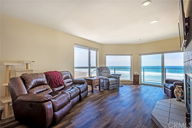"Ocean front living – Captivating panoramic oceans views are just the beginning of this spacious single-level home's appeal. The floor plan is open and airy and allows spectacular ocean views from the living room, private balcony, dining area, and kitchen. The floor-to-ceiling windows and comfortable fireplace create an ""oh,so relaxing"" coastal ambiance. New cedar series wood-like flooring and fresh paint enhance the interior, as well as newer motorized sun shades.The kitchen is well equipped withOcean front living – Captivating panoramic oceans views are just the beginning of this spacious single-level home's appeal. The floor plan is open and airy and allows spectacular ocean views from the living room, private balcony, dining area, and kitchen. The floor-to-ceiling windows and comfortable fireplace create an ""oh,so relaxing"" coastal ambiance. New cedar series wood-like flooring and fresh paint enhance the interior, as well as newer motorized sun shades.The kitchen is well equipped with gas cooktop, oven, trash compactor, dishwasher and new stainless steel refrigerator and microwave. The master bedroom offers a large walk-in closet, and the master bath provides a Safe Step® walk-in spa tub, separate shower, and dual sink vanity. There are two well-proportioned secondary bedrooms and additional baths. Separate laundry room with great storage. This unit comes with two side-by-side secured parking spaces. An elevator conveniently whisks you straight up from the parking garage to your front door. Your view includes not only the occasional dolphins frolicking in the beautiful Pacific Ocean but also phenomenal views to Coronado Island and neighboring Imperial Beach Pier. Oh, did I mention the sunset views are simply amazing! Come, feel the ocean spray, and breathe in the salty air – this is truly a lifestyle.."