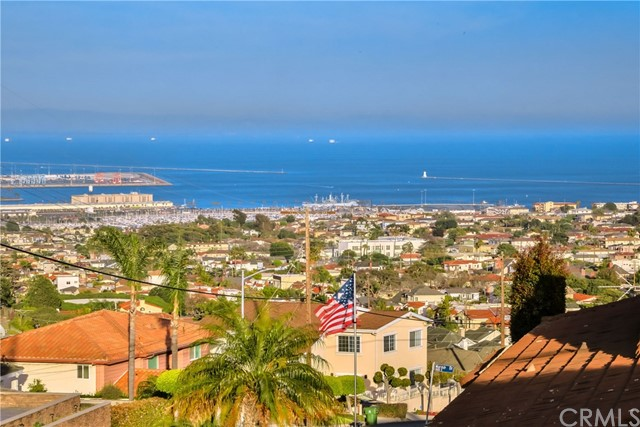 Rare opportunity for spacious view home in Upper South Shores. Corner lot with over 3,225 Sq Ft of living space features panoramic ocean views and golden sunsets reflected from The Downtown Los Angeles Skyline.  Entertainer's delight with loft style foyer, open floor plan, expansive wet bar and 3 car direct access garage. Gourmet Chef Kitchen with walk-in pantry, built-in barbecue grill, double oven, oversized island and raised granite countertops. Duo breakfast bar seats nine. The Master Suite with ocean views boasts exclusive access to wrap around deck with exterior spiral staircase to in-ground spa. All 4 bedrooms on second floor. Total of 3 bathrooms. Meticulously presented includes 7 ceiling fans, crown molding, recessed lighting, dual pane windows, walnut hardwood floors and more. Cozy-up by the fireplace or the patio with warm Pacific breezes. Close to Cabrillo Beach, California Yacht Club-Cabrillo Marina, Cabrillo Marine Aquarium, LA Waterfront Development, Trump National-LA Golf Club and Terranea Resort. Short drive to I-110 Harbor Freeway. Request full feature list today!