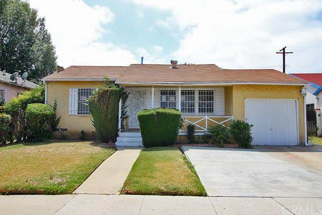 ***SINGLE FAMILY HOME IN COMPTON*** This 2 bedroom, 2 bathroom home features include:  3 steps up to a covered concrete front porch opening to living room with stone gas fireplace and dining area with ceiling fan/light combination, gas wall furnace and direct access to the 1 car attached garage.  The main hallway off of the living room affords access to the full hall bathroom with combination bath tub/shower and bedroom one.  Bright and open kitchen with vinyl floors, tiled counter tops, double sink with garbage disposal, free standing stove with vent hood, dishwasher, trash compactor, plus a side door opening to the North side yard.  Behind the kitchen is the large family room with inside laundry area, open beam ceilings, wall air conditioner, gas wall furnace and glass slider opening to a cinder block fenced backyard with concrete open patio, storage shed and water heater closet.  Rear bedroom situated off of the family room with two portable-type closets, ceiling fan/light combination, walk-in closet and private full bathroom with combination bath tub/shower.  DON'T MISS OUT ON THIS OPPORTUNITY!!!