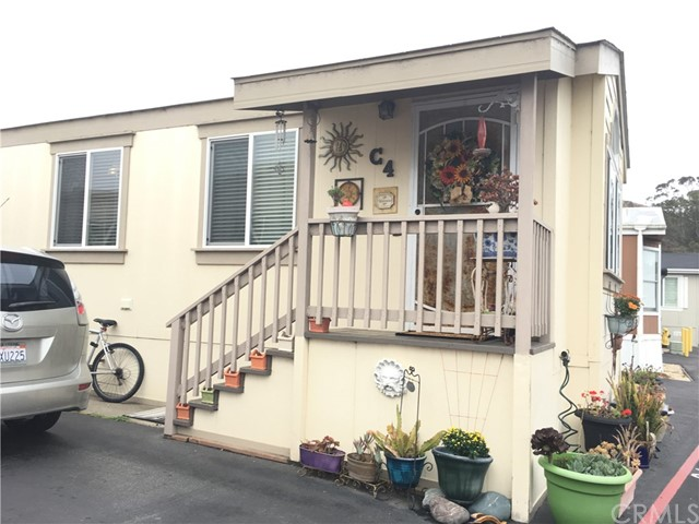 A short distance to our Morro Bay sand, surf and magnificent Rock, you will enjoy living on our Central Coast in this lovely open  floor plan manufactured home. Located in a Senior park (55 & over) it features 1 large master bedroom and a smaller bedroom, 1 bath, new vinyl plank flooring throughout, there is a sliding glass door opens to the patio, and all appliances are included (new dishwasher and washing maching).  This home is a 2009 Skyline (16 by 60) 960 sq. ft. with an enclosed patio/yard. Seller had a custom wooden and glass studio built with access to electricity and has many options for use. Also has a smaller shed and pavers on this 8 by18 foot patio. Dog run in back of the home (pet friendly park with okay from manager). A must see to really appreciate. Very clean. Turn-key, move in quickly.