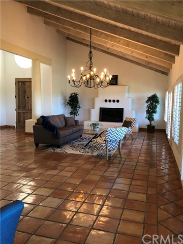 Offered for sale at $1,985,000! This truly magnificent home was designed by well-known and often copied Southwestern Architect, Benny Gonzales. Majestic landscaping and a large, proper fountain greet you as you approach this incredible home. Hand-troweled walls and traditional Saltio tile floors lay both inside and out and line your path as you explore the grounds. Antique church doors imported from Baja open to a magnificent dining and spacious kitchen. The Spanish tile rooftops on the many structures are quite a sight to behold from the sky. Accommodating Verandas surround the home, and a walled garden and Spanish gates off the bedrooms are tranquil. Located on 10 fenced and cross-fenced acres on the East side of the 101 in the Nipomo foothills, there is even a view of the Avila Bay in the distance. The main home consists of 3 spacious bedrooms, 2 1/2 baths, and a whooping 4400 sq ft. There is an ample 3 car garage that has a separate studio apartment located above. The list of features include a French tankless water heater, a large walk-in rock pantry, custom cabinets, wine cooler and storage, an indoor BBQ pit in the kitchen, and stainless appliances and granite counters throughout! All internal walls have been double insulated! There's a large backyard patio with BBQ pit, fireplace and koi pond, five stall barn with runs, tack room, wash rack, wine cellar, storage and work area. Skylight in barn with Oklahoma stone flooring inside and out. Boccie ball court and horseshoe pits. Separate barn for hay/storage. Small riding arena, round pen, 5 pastures and 3 dog kennels. New seal coat on driveway! Stunning property, great for entertaining! Please see virtual tour for many more pictures!