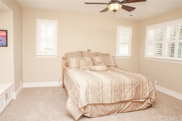 Spacious master suite with ceiling fan/ light with