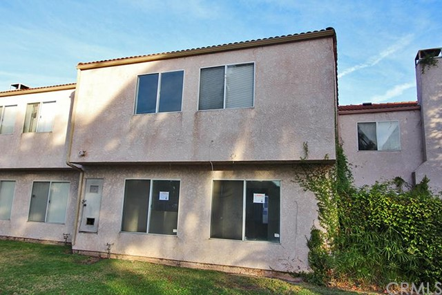 ***TWO STORY PUD (TOWNHOUSE STYLE) IN DESIRABLE HERITAGE ESTATE OF COMPTON GATED COMMUNITY*** This 3 bedroom, 2.50 bathroom PUD features include: 2 car detached garage with automatic opener separated from the home with a private front courtyard to a tiled entry. Spacious living room with gas stubbed fireplace and mirrored walls on two sides. To the right of the entry is a coat closet and guest 1/2 bathroom, plus stairs which opens to the main upstairs hallway. The main hallway affords access to 2 bedrooms with views of the community pool and green belt, 1 full bathroom with bath tub/shower combination, plus the owner's suite with double doors , mirrored closet sliders, private full bathroom with bath tub/shower combination and a slider door to access a private balcony overlooking the front courtyard. Open and airy kitchen with tiled flooring/counter tops, double sink, garbage disposal, dishwasher and vent hood. Adjacent to the kitchen is the family/dining room with a mirrored wall and inside laundry closet. This community affords amenities including: pool, spa and basketball court. DON'T MISS OUT ON THIS OPPORTUNITY!!!