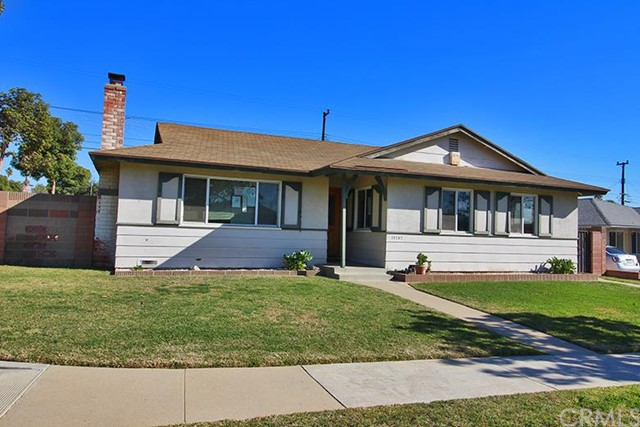 ***SINGLE FAMILY HOME IN CARSON*** This 4 bedroom, 1.75 bathroom home features include: 2 steps up to a covered concrete front porch opening to an entryway with hardwood floors opening to the left to a living room with wall-to-wall carpet and a wood-burning fireplace.  the entry also leads straight to a dining area adjacent to the kitchen with island cook top, vent hood, tiled counter tops, parquet floors, composite counter tops, double stainless steel sink, dishwasher, built-in oven, and breakfast nook.  Step-down family room with wall-to-wall carpet and a stone wood-burning fireplace leading to an inside laundry room with tiled floors to a 2 car attached garage with opener.  The laundry room also features a side door opening to the street and concrete driveway and the rear door opens to the backyard; fenced with cinder block and wood.  The main hallway affords access to 3 bedrooms and a full hall bathroom with tiled floors, plus a owner's suite with private 3/4 bathroom with pedestal sink.  DON'T MISS OUT ON THIS OPPORTUNITY!!!