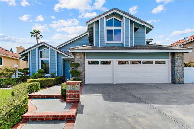Stunning pool home just remodeled with a modern flare and nestled on a cul-de-sac street.  Bright and airy entry, formal living and dining room with beautiful new oak wide plank hardwood engineered flooring.  The gourmet kitchen has just been remodeled with brand new white shaker style cabinets, glass tile backsplash, quartz counters and KitchenAid stainless steel appliances.  Kitchen features a breakfast nook and overlooks the family room.  The comfortable family room includes a stone fireplace.   Main floor bedroom suite with it's own private bathroom.  The master suite includes a retreat area and gorgeous bathroom with porcelain tile flooring and shower, jacuzzi tub, new dual sink vanity with quartz counters and new fixtures.   Spacious secondary bedrooms and remodeled hall bathroom as well with brand new vanity, quartz counter, new flooring and fixtures.  New interior and exterior paint, baseboards, flooring, carpets and sliding glass doors and dual pane windows throughout most of the home.  Large lot with 10,500 square feet including a private pool and spa great for relaxing or entertaining outdoors plus RV parking.  California Distinguished schools and Yorba Linda High School boundaries.  Close to the Bryant Ranch and Brush Canyon Parks, shopping, freeways and much more!