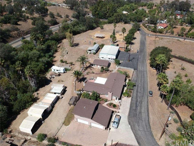A phenomenal 4.59 Acre property with so many options for use. 4.59 Acres Home: 3 Bedroom 2 bath 2108 square feet Guest House: 1 bedroom 1 bath 500 square feet 4 Car Garage 1700 sq ft with Loft and storage above 2 car spaces, 220 volts at the panel built 2016, 2000 SQFt Agricultural building, 2 Shipping containers used for storage, 2 RV carports, Tool shed with electricity, Metal Shed, Wooden Shed, 4 legal RV spots, Small studio (rented to dog trainer) additional Outside bathroom, Private Road Agreement (5A phenomenal 4.59 Acre property with so many options for use. 4.59 Acres Home: 3 Bedroom 2 bath 2108 square feet Guest House: 1 bedroom 1 bath 500 square feet 4 Car Garage 1700 sq ft with Loft and storage above 2 car spaces, 220 volts at the panel built 2016, 2000 SQFt Agricultural building, 2 Shipping containers used for storage, 2 RV carports, Tool shed with electricity, Metal Shed, Wooden Shed, 4 legal RV spots, Small studio (rented to dog trainer) additional Outside bathroom, Private Road Agreement (5 Board Members), The pond used for watering yard with pump, 3 power meters (one residential, one commercial, one agricultural), 2 Septic Systems (bottom septic tank 5 years old) 17 horses permitted(buyer to verify with the county) Plenty of room to be adventurous. Home, guest house, loft, Agricultural building, and the studio is all rented out. Water stream & pond part of the San Luis Rey Estuary.