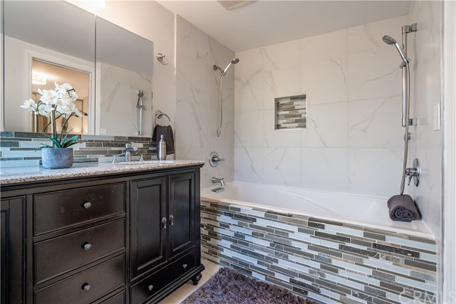 Dual sinks, 6 feet soaking tub with dual showers