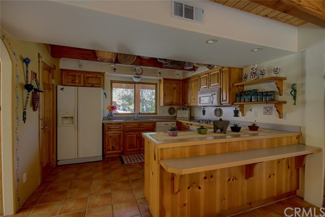Knotty pine cabinets in kitchen.