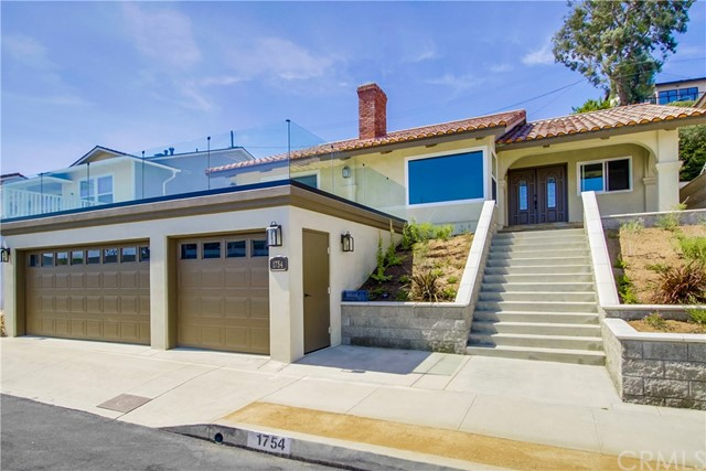 Immaculate turnkey, completely remodeled South Shores home with ocean and Catalina views. No expense spared. Double door entry. Beautiful wood floors throughout. Living room with vaulted ceiling with crown moldings and gas fireplace. Family room has a dome ceiling with bar and gas fireplace which leads to doors opening to a large viewing deck completely glassed in. Large open kitchen with breakfast bar and new custom cabinets, granite counters and all new stainless appliances, double oven and refrigerator. New heating system, new water heater, new windows. All New bathrooms with walk in showers. Separate laundry room with cabinets and granite counters with sink. 3 car garage