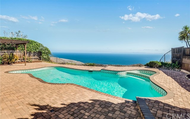 UNOBSTRUCTED, PANORAMIC, BREATHTAKING... BEST DESCRIBE THE OCEAN AND CATALINA VIEWS FROM THIS DESIREABLE HILLTOP HOME.  This incredible location also takes in a glimpse of sunrises, sunsets and hawks soaring over the switchback.  The views are visible from almost every room in the house. Did I mention the  pristine golf course views?  This light and bright 4 bedroom, 3 bath home is situated on a quiet cul-de-sac in sought after Rancho Palos Verdes.  Enjoy the never ending views and tranquil ocean breezes from the rear patio and in-ground pool & spa.  Spacious master suite with fireplace and yes, stunning views.  Other amenities include:  central a/c, newer carpeting, interior recently painted, hardwood flooring in entry, paver style patio and pool decking, kitchen opens to family room, huge living room w/fireplace, stamped concrete driveway and attached two car garage, etc...