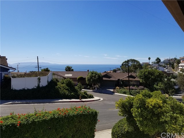 This hill top diamond in the rough, with ocean and canyon views,  is the fixer upper you've been waiting for! And, this is the first time this treasured family home has been offered For Sale. The minute you step through the front door you will know this is home. Master bedroom on the entry level, with huge living area that features a fireplace, decks and balconies. Large family room and 2 bedrooms downstairs. Situated at the top of highly desirably Mermaid Drive, there are sunset ocean views from the front porch, the home backs up to beautiful Deane Dana Friendship Park & Nature Center which provides ultimate privacy. Floor to ceiling windows and sliding doors shower the rooms of this home with natural sunlight. The huge center courtyard is the perfect spot for outdoor dining and entertaining.