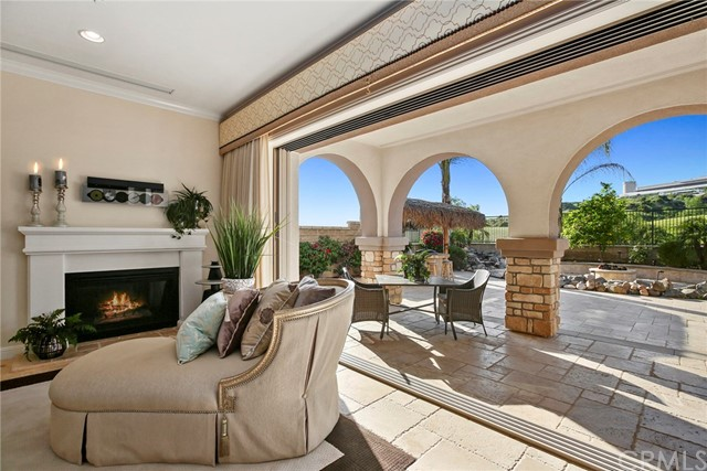 Stunning LUXURY HOME on a PREMIUM HOME SITE located in Toll Brothers-Built Heritage ON the Black Gold Golf Course with SUNSET VIEWS *** Seller is entertaining offers between $1,199,888 and $1,249,888 * Soothing monochromatic color scheme on main floor with extensive use of TUMBLED TRAVERTINE laid in a pattern flows from interior to exterior * Kitchen and Great room are Enhanced by 15 FOOT DISAPPEARING DOOR and a salt water aquarium * Kitchen with island, stainless appliances including Kitchenaid refrigerator, 2 drawer dishwasher, 6 burner range, rich granite counters and full back splash, walk in pantry, and nook all open to over sized great room with projector and pull down movie screen * Outside experience paradise in your resort like backyard, on the course, palapa-covered built in bbq bar, above ground spa for 8, palapa covered Korean bbq, rock stream with a fire pit * Side gate for convenience * Main floor den could be bdrm or dining room or ?, powder room, laundry room w/sink * Up the elegant, curving wrought iron upgraded stairway are the 3 bedroom suites * Espresso hardwood flooring on whole 2nd level* Sumptuous master suite with large retreat area, enjoy your coffee on your large balcony with golf course view, Custom Drapery, Large walk in closet, bath with polished stone flooring, stone walk in shower, jetted tub, dual granite topped vanities - VERY CHIC * Two more suites upstairs, 1 with balcony and view to south. Has a full driveway, attends Lakeview Elementary!
