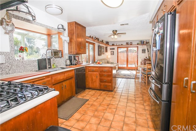 Wonderful Kitchen with Corian counters; Garden Window; newer stove and dishwasher and lots of cabinets!