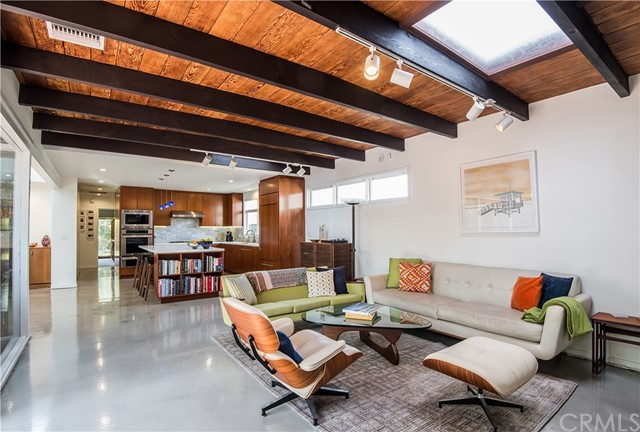 Welcome to this Rare, Tree Section, Mid Century Modern, Post & Beam home - expertly remodeled in 2014 in a contemporary approach to the original 1950's aesthetic, on a large elevated 5,060 sf lot.  The one level, fully air conditioned 1800sf house enjoys 3 Bedrooms, 2 Baths + Den, with a Kitchen designed for entertaining, Living Room with wood burning fireplace, and Dining Room with elevated ceiling - all framed by floor to ceiling glass walls, opening up to a large, landscaped Private Patio which stream sunlight throughout the home.  Perfect for indoor-outdoor living and entertaining.   