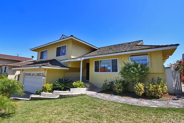 ***TWO STORY CONTEMPORARY SINGLE FAMILY HOME IN HARBOR CITY***  This 3 bedroom, 2.50 bathroom home is located on a cul-de-sac street with features including: concrete covered front porch opening to a tiled entryway; dining area with ceiling fan/light combination and tiled floors; kitchen with granite-like counter tops, dishwasher, double stainless steel sink, garbage disposal, built-in oven, gas cooktop, vent hood and tiled floors; spacious living room with gas stubbed wood burning fireplace and glass slider leading out to a split level concrete patio.  Stairs down off of entry open to an open family room with glass slider opening to the rear concrete patio, direct access to 2 car garage from the family room with laundry area and water heater, plus a guest 1/2 bathroom conveniently located off of the family room.  Stairs up from hallway afford access to 2 bedrooms and a full hall bathroom with combination bath tub/shower, plus an owner's suite with ceiling fan/light combination and private 3/4 bathroom.  DON'T MISS OUT ON THIS OPPORTUNITY!!!