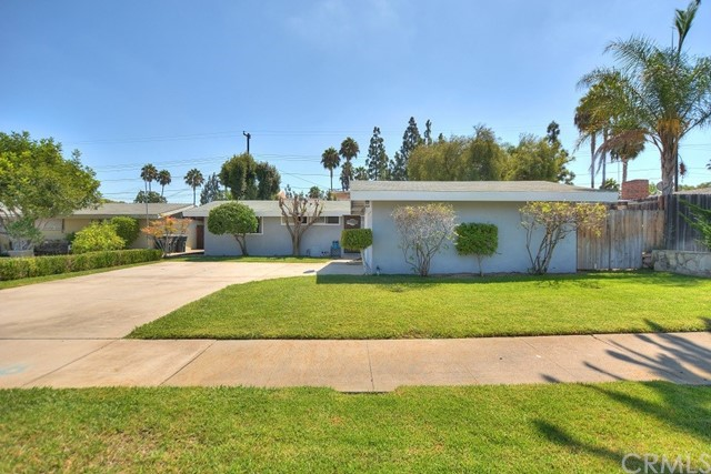 Welcome to this stylish mid-century modern single story home located close to downtown Orange and Chapman University.   This lovely 3 bedroom, 2 bath home features vaulted ceilings, laminate and tile flooring in the living area, open kitchen with pantry and updated cabinets, living room with fireplace and recessed lighting, master bedroom with updated master bath, ceiling fans in all 3 bedrooms, newer water heater and private back yard.  Close to shopping and restaurants, easy access to the 57 frwy. This charming home is a definite must see !!