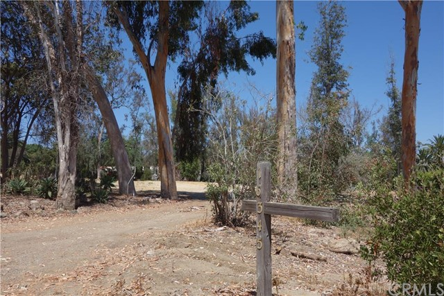 2.03 acre nearly level lot on quiet idyllic road in the Covenant of Rancho Santa Fe. Walk to Ewing Preserve, hiking/horse trail system and RSF village. About twelve minutes to the Pacific Ocean and beachside resorts of Del Mar and Solana Beach. Short drive to Osuna Ranch and Chino's farm. Current owners have removed prior existing 1950's era house, obtained soils testing and perc test for 5 bedroom home. Water and electric on property. Community boasts private Golf Club, Tennis Club, ball fields, Equestrian facilities, Garden and Library Clubs. Negligible road traffic/noise makes this parcel a secluded paradise!