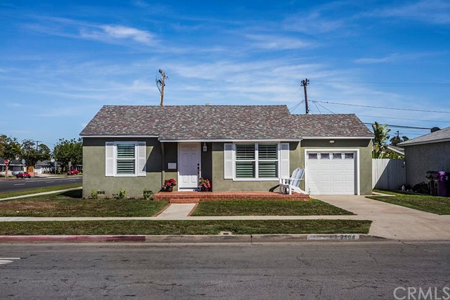 **RECENTLY UPDATED HOME IN HIGHLY DESIRABLE LOS ALTOS NEIGHBORHOOD OF LONG BEACH** This charming 2 bedroom, 1 bath home features include: large corner lot with beautiful brick front patio (perfect for relaxing on those summer evenings).  Front entry into the spacious living room with laminate floors, recessed lighting, dining room adjacent with laminate floors, ceiling fan/light combination.  Open and airy kitchen with stainless steel range/microwave/double sink/dishwasher, granite counter tops, disposal, recessed lighting and breakfast bar which steps down into the large family/sun room with ceiling fan/light combination and doors that lead out to the over-sized and lushly landscaped backyard with red brick patio (perfect for entertaining) plus a gardening plot and storage shed.  The main hallway off of the living room affords access to both bedrooms and a full hall bathroom with combination bath tub/tiled shower plus a pedestal sink. 1 car attached garage with washer and dryer hookups.  Additional upgrades made to this home include:  new custom interior and exterior paint throughout, dual paned windows, beautiful crown and base board molding throughout, plantation shutters, and much more.  DON'T MISS OUT ON THIS GREAT OPPORTUNITY!!!
