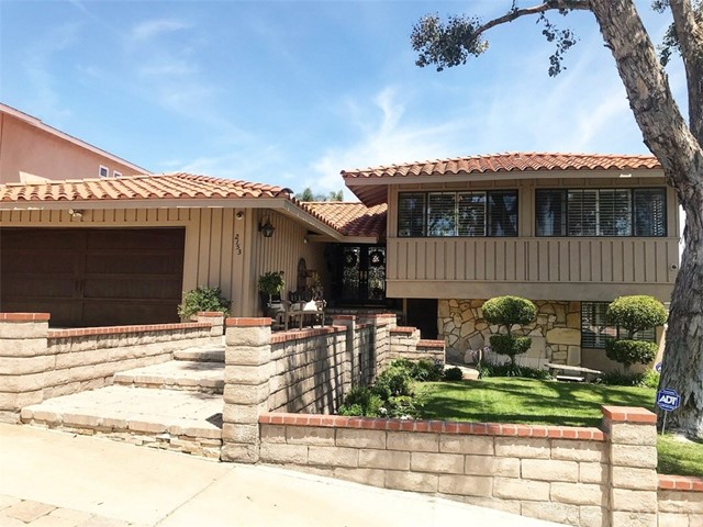 Welcome to this tastefully remodeled family home in Rancho Palos Verdes, on a cup-de-sac street. Enter through a double beveled glass entry door to the main level of the home with a beautiful rustic wood paneling entryway. You'll immediately notice the large bright open living area and dining room, with all new hardwood flooring, designer lighting, and fireplace. The kitchen has all been remodeled with custom cabinetry and stainless steel Thermador Appliances including, 60' commercial range with griddle, microwave, wall oven, refrigerator, dishwasher, wine refrigerator.  The kitchen features a large 10ft island with plenty of storage and custom lighting under all cabinets.  You'll find even more storage in the large custom walk-in-pantry. Master bedroom and 2 other rooms upstairs. Brand new hallway bathroom with carrera marble. Master bathroom also remodeled with spa tub/shower, and quartzite. Downstairs you'll find the 4th bedroom and 3/4 bathroom.  Downstairs also features a second living area and a fireplace. This home was has a new air conditioning featuring a dual control for each floor. The backyard has two levels. The top level off of main level living area has french doors leading into a covered patio with a built in fan, large grassy yard with many fruit trees and beautiful landscaping. There is a built-in fire pit perfect for entertaining.  The second level of the backyard you'll find the pool/jacuzzi, with designer mosaic stone work and new pool equipment.