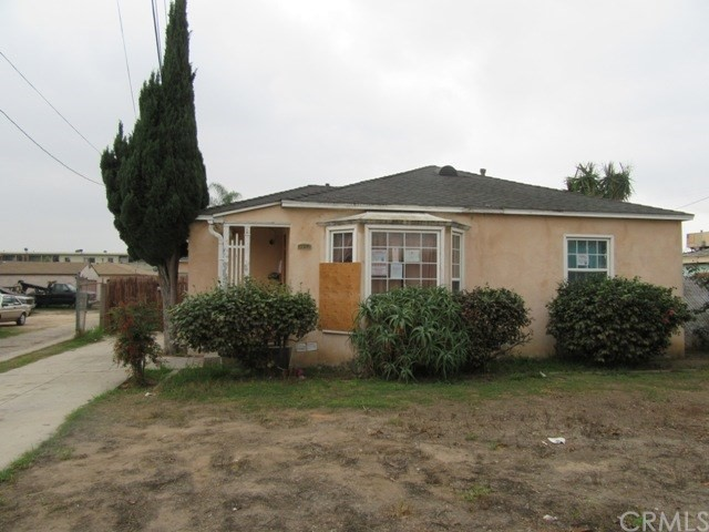 ***SINGLE FAMILY HOME LOCATED IN SOUTH INGLEWOOD*** This 2 bedroom, 1 bathroom home features include: covered front porch which opens to the living room with wood floors, gas floor furnace and adjacent to the open dining area next to the kitchen with tiled floors, composition counter tops, double stainless steel sink with garbage disposal, vent hood, free standing gas stove.  Laundry/utility room with back door leading out to a cinder block fenced backyard and a 2 car detached garage with automatic opener and storage shed.  The main hallway off of the living room affords access to a full bathroom with combination bathtub/shower, tiled floors; and affords access to the two bedrooms.  DON'T MISS OUT ON THIS OPPORTUNITY!!!