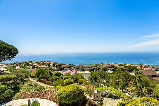 Magnificent panoramic ocean, coastline and Catalina views from most rooms in this spacious home. A rose garden with gated arch welcomes you to this family residence and a double-door entry leads into a wide-open living and dining area. The views immediately draw you to the windows and rewards you with a 180-degree view of the coastline that captivates you by day, and mesmerizes you at sunset! A patio, koi pond with waterfall and a viewing deck enhance the peaceful outdoor experience. Explore the kitchen to find a double-oven, plenty of cabinets, range, dining nook and sliding door out to the front patio. On the lower level, a large family room offers plenty of space to relax with a wet bar, ¾ bathroom, and sliding door out to the rear patio. Direct access to the 2-car garage with laundry hookups. Upstairs the Master Suite has beautiful views, walk-in closet and ensuite bathroom. New flooring throughout the upper floor leads to 3 more bedrooms (2 with ocean views) and a full bathroom with new tub/shower. A great opportunity to upgrade now or move in and upgrade later. Award-winning Palos Verdes schools and Marymount University nearby and enjoy the luxurious amenities at Terranea Resort.