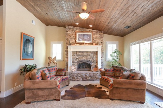 Rock floor to ceiling gas auto light fireplace wit