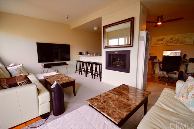 "ALL UTILITIES INCLUDED! DO NOT DISTURB TENANT! Unfurnished, except for the Murphy Wall bed systems which are attached to the walls, but tenant may bring their own mattresses.  This 1 bedroom condo in the Sea Harbor Villas is an end unit located on the top floor.  There is a 65 inch television in the living room and 50 inch television in the bedroom. Most of the lighting is on voice control.  There is a nice balcony with a view of the bay from the kitchen and deck.  Couches and converting coffee tables slide out of the way to reveal a queen size Murphy Wall bed in the living room, which has a very nice mattress.  The bedroom also has a Murphy Wall Bed.  The bathroom is equipped with a Nebia luxury water-saving shower system.  This is in a great location on the street just above the Embarcadero and close to the downtown area of Morro Bay, where you may enjoy a weekly farmers market, two grocery stores, lots of restaurants, and even a movie theater.  No Pets allowed.  This property is very quiet and tranquil.  There is one subterranean covered parking space included, two guest parking spots, and a laundry room in the building.  The Murphy beds are attached to the walls and cannot be removed, but all other furniture can be.  Available July 15th.  Owner is a real estate licensee. New photos and video walk-through coming soon! Internet and Cable Television services if desired are at tenants expense and are not included among the ""utilities"" provided by Landlord."