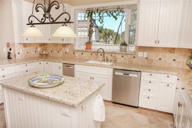 Center island with granite top, light, drawers and