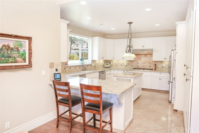 True gourmet kitchen with 32 custom cabinets toppe