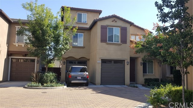 This 7 year young, almost 2100 SFT is a Turn Key 3 story 3 Bedroom condo In the City of Orange. A commute friendly home and minutes away from 91, 57 and 55 freeways. Very close to shopping area. The combination of hard wood flooring, upgraded carpet, granite counter tops, mirrored closet doors, walk in closet in Master suite, Stainless Steel appliances, and 3 level floor plan will make this property very appealing and functional. Formal living room, family room, and kitchen on First floor and all bedrooms on 2nd floor. The top floor has a den that can be your retreat, office or possibly the 4th room. Let's not forget the small cute patio in the back that has artificial grass, re-tractable awning with LED lights, and all plumbing and gas connection already in place. A perfect spot for your evening get togethers or just a comfort place for a cup of coffee in the evening. A large 2-car garage  with 2 separate rolling shutters with ample storage. Property sits in the Pebble Creek community which features a gorgeous pool/spa, an expansive children's park with large play structures, tennis courts, a community center, and walking trails along the Santa Ana river. Let's make this YOUR next home before it becomes THEIRS!!