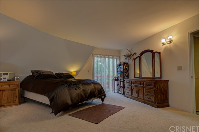 Large master bedroom, with walk-in closet, private bath and space for an office area.