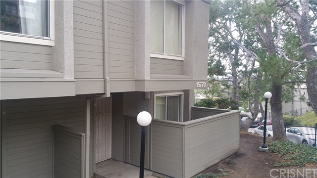 Two-Bedroom, Three-Bath Condo in the heart of Granada Hills - Tri-Level with small patio area, and attached Two-Car Garage.  Home is needing repairs.