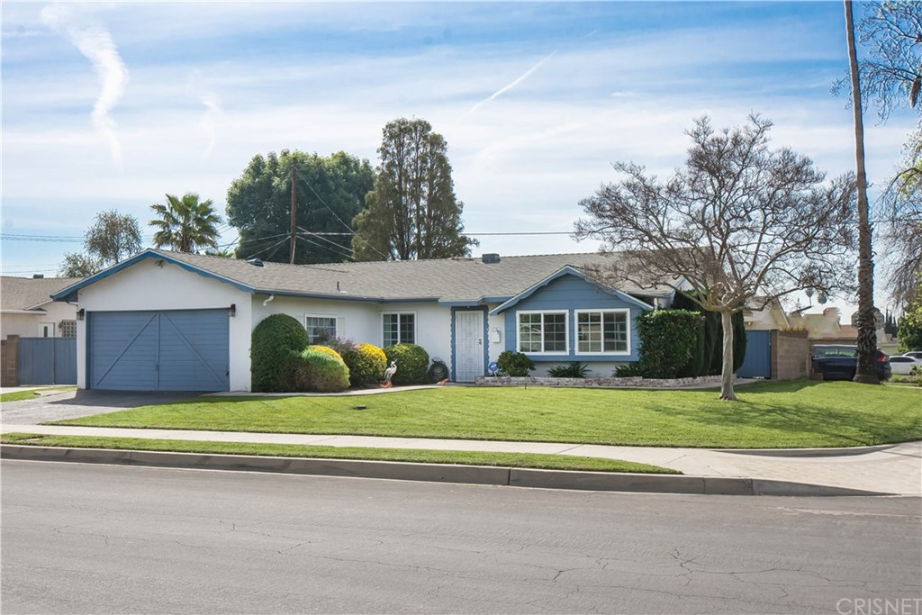 Upgraded North Hills home located on a desirable corner lot.  Larger yards with ample RV parking on side.  Upgraded windows, roof, plumbing, Kitchen, and Bathrooms....Covered patio with 2-car attached Garage.  Must see this great home!