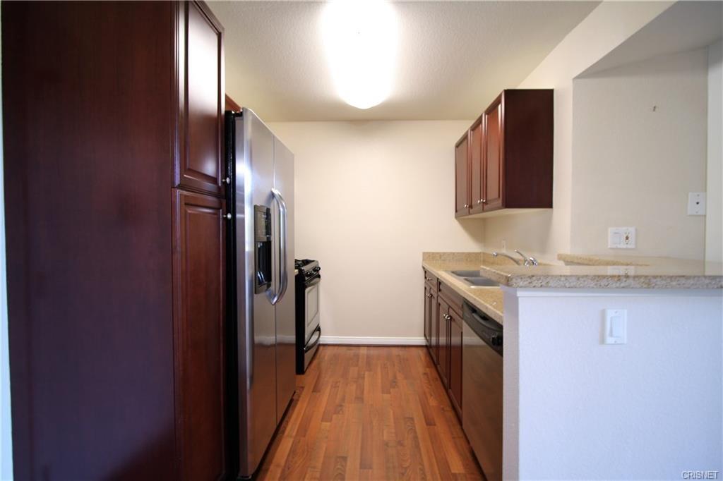 5545 Canoga Avenue, Woodland Hills CA: http://media.crmls.org/mediascn/5572cd4c-29c9-414c-a2c5-29149b681ad7.jpg