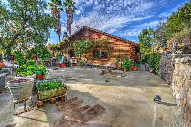 What an opportunity to own a magnificent Malibu log cabin home!! This property must be toured to be appreciated. It features a main house that is 3 bed, 2 bath, 1656 square feet and is a wonderful country retreat with a large stone fireplace, wood accented ceiling, wood and tile flooring, gourmet country kitchen with large island, front porch, giant front sun deck and additional rear patio and much more!! The detached garage has also been converted to living space with a separate small apartment like studio and an additional office. There is also another small one bedroom plus loft building off the secondary patio. As if all of that wasn't enough there is also garden and orchard area next to the house that looks amazing in the spring. This one of a kind property is located on nearly 40,000 square feet of prime Malibu land. Must be seen to be appreciated!!