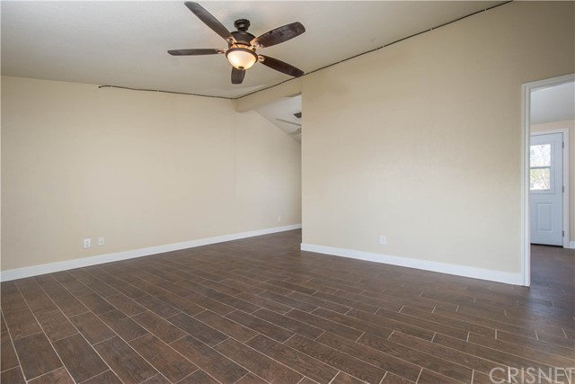 Move in ready! Renovated three bedroom and one bath home in Canyon Country.  New Wood tile flooring, new carpet, new double pained windows, roof just installed, just pained out side exterior, new electrical panel.   No Pets, No Exceptions. 1-Year Lease required.  Landscape included. Occupants responsible for utilities.  Washer and dryer hook-up's in the garage, washer, dryer and refrigerator not included.  Lockbox located on the right side of the house (to the right of the garage).