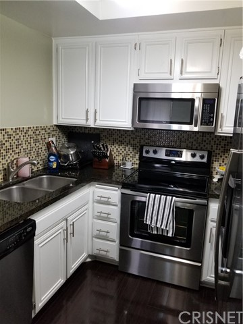 Condominium for Sale at 22100 Burbank Boulevard Unit 348 22100 Burbank Boulevard Woodland Hills, California 91367 United States