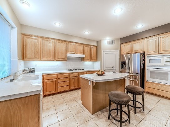 11760 Mariposa Bay Lane , CA 91326 is listed for sale as MLS Listing SR18106234